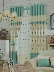 Eclipse Embroidered Umbrella Stitching Style and Ruffle Grommet Curtain (Color: Celadon Green)